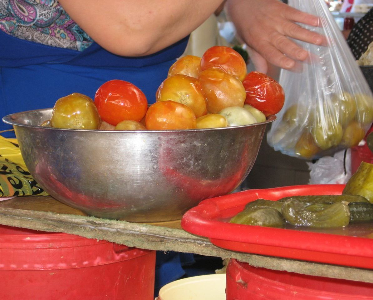 Brine-pickled tomatoes, like other pickles, are sold drained. You take ...